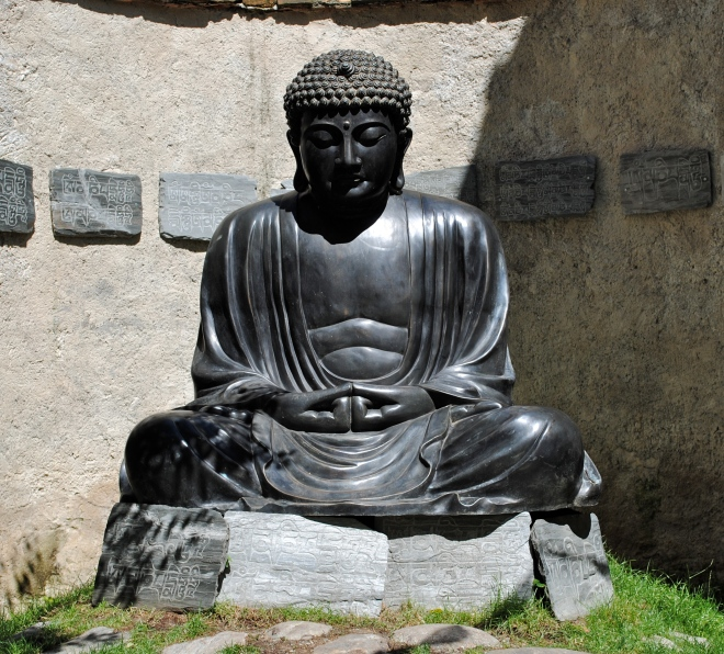 Buddha, at the entrance of MMM Ripa
